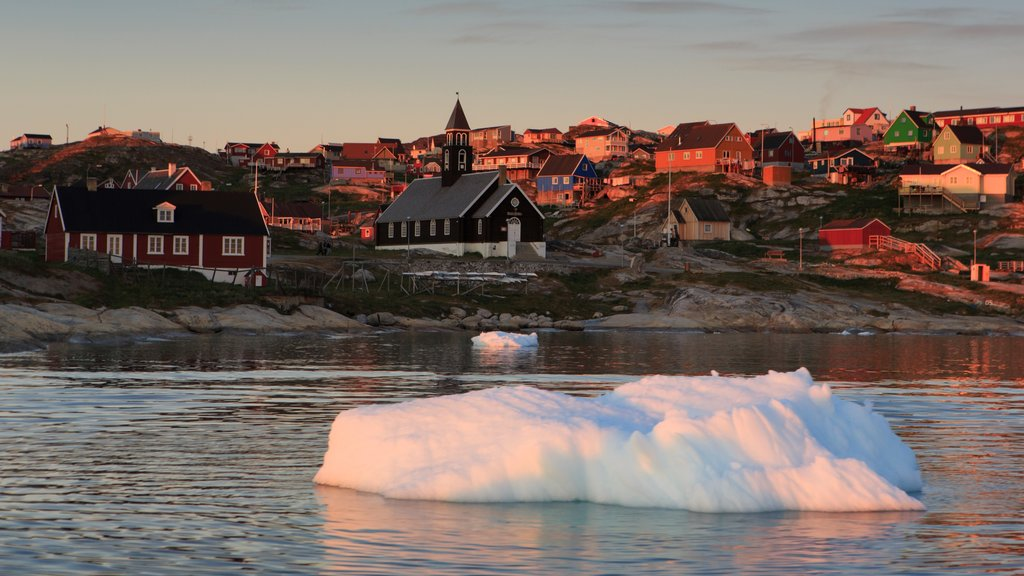 Ilulissat featuring a sunset, a lake or waterhole and a city