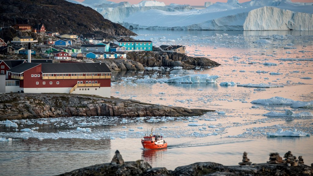 Ilulissat featuring rocky coastline, snow and boating
