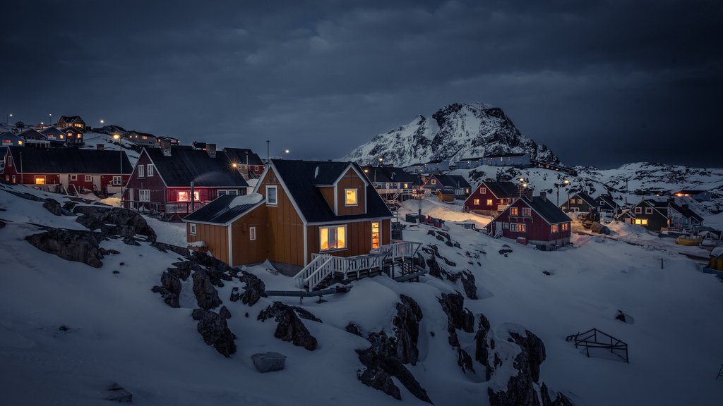 Sisimiut featuring snow, night scenes and mountains