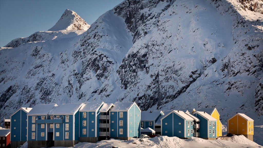 Sisimiut which includes snow, a small town or village and mountains