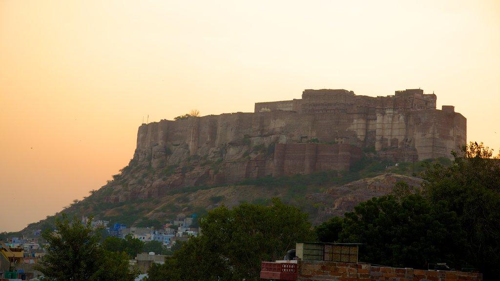 Mehrangarh Fort featuring a sunset