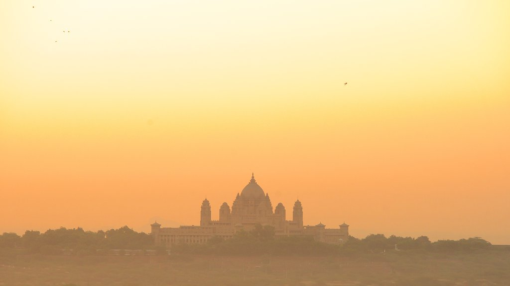 Umaid Bhawan Palace which includes a castle and a sunset