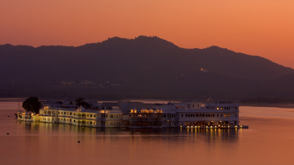 Lake Palace showing a coastal town, a sunset and general coastal views