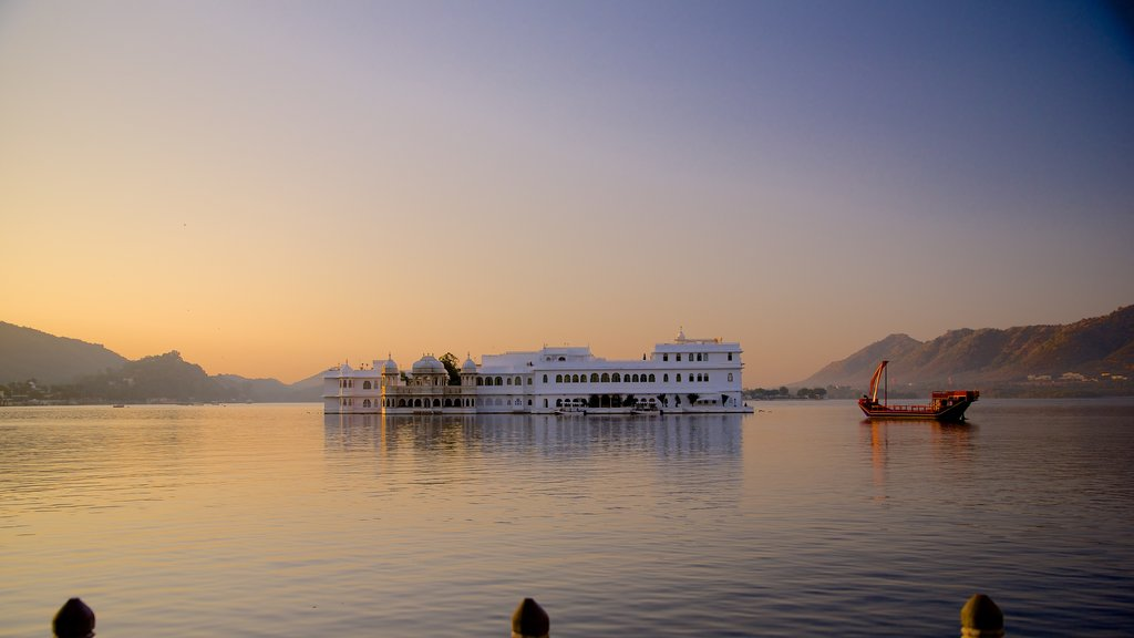 Lake Palace showing a sunset, boating and a lake or waterhole