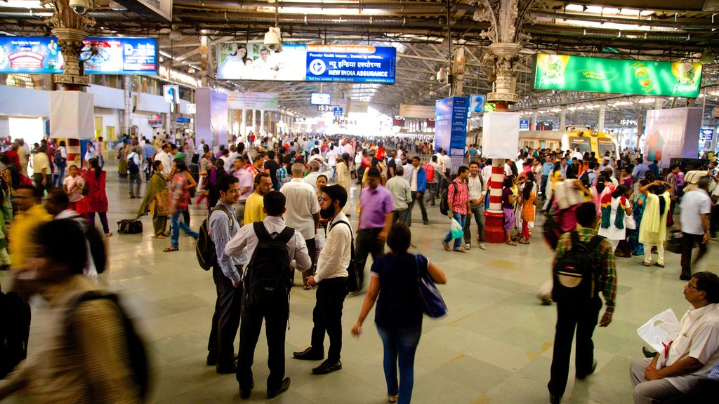 Chhatrapati Shivaji Terminus showing interior views as well as a large group of people