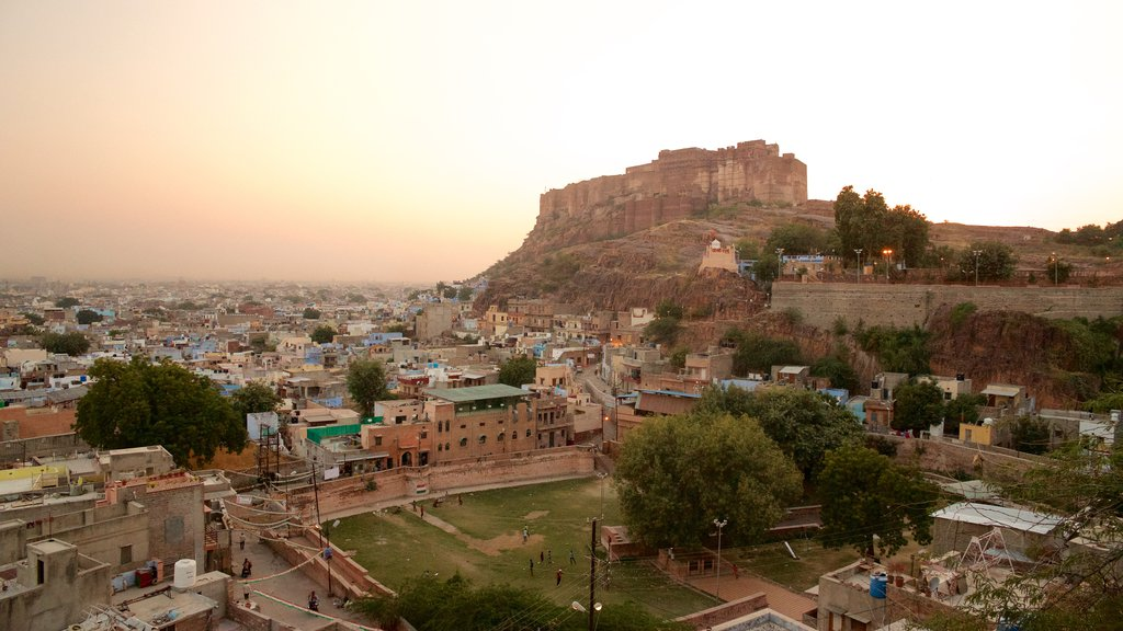 Mehrangarh Fort featuring a city and a sunset