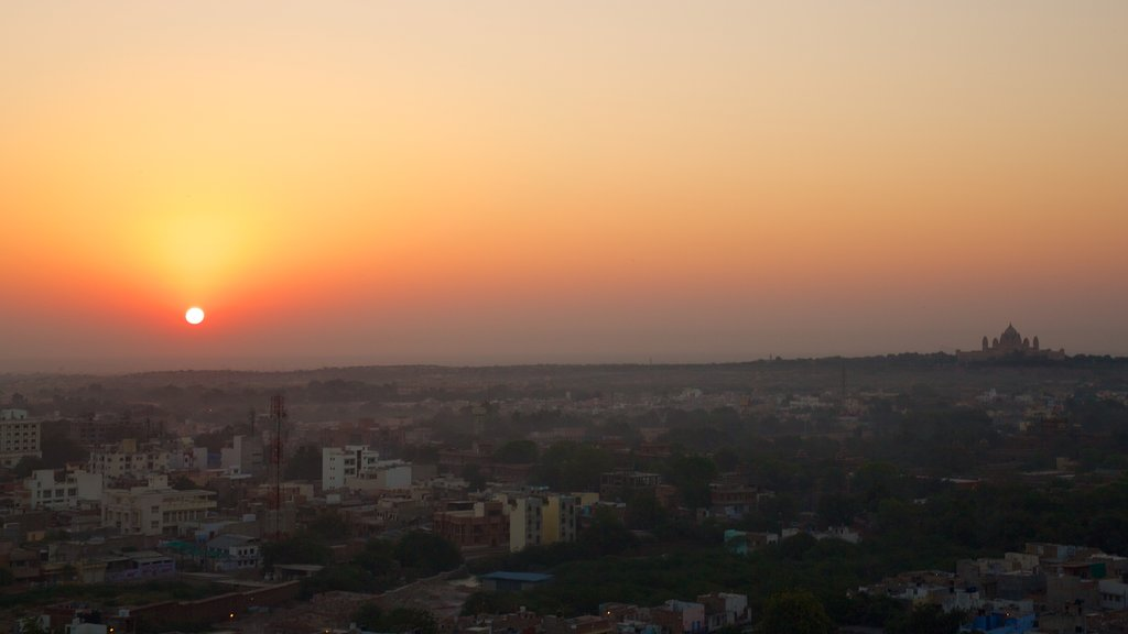 Umaid Bhawan Palace which includes a city and a sunset