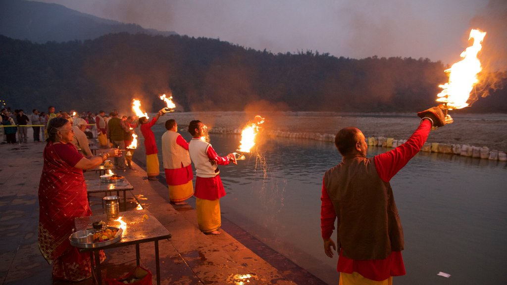 Triveni Ghat which includes a sunset and religious elements as well as a small group of people