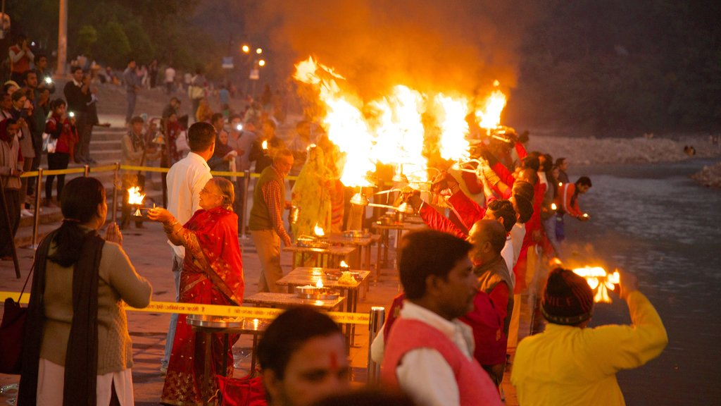 Triveni Ghat featuring a river or creek and religious aspects as well as a large group of people
