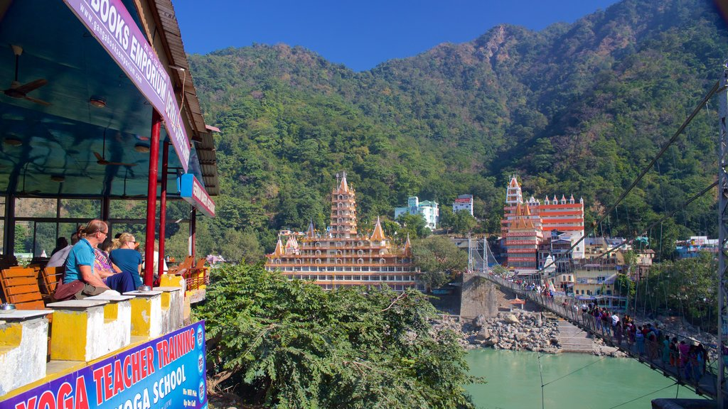 Lakshman Jhula which includes a suspension bridge or treetop walkway, a river or creek and a small town or village