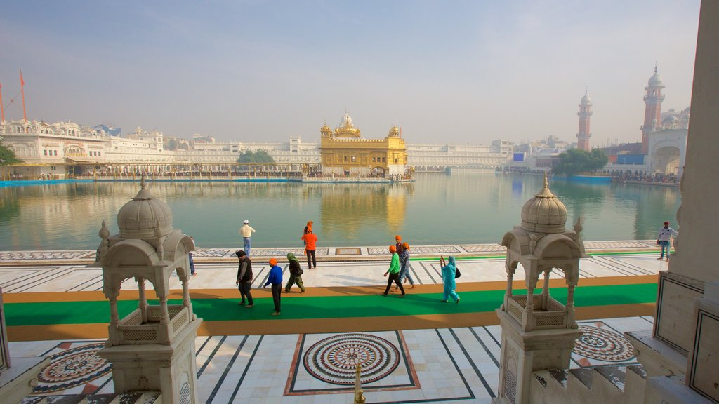 Golden Temple which includes a lake or waterhole, heritage architecture and heritage elements