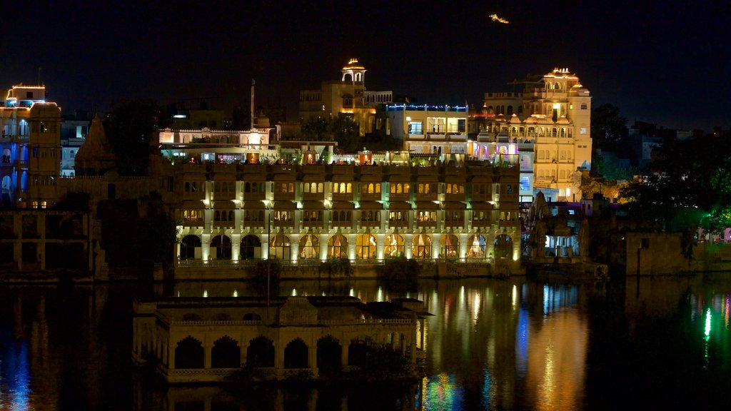 Udaipur which includes a city, night scenes and a lake or waterhole