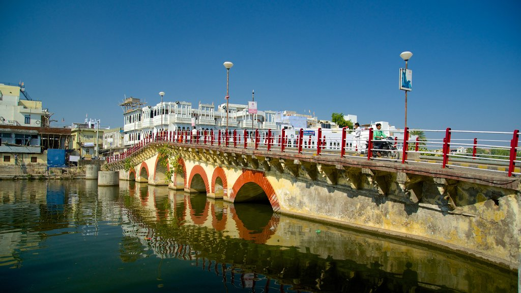 Udaipur featuring a bridge and a river or creek