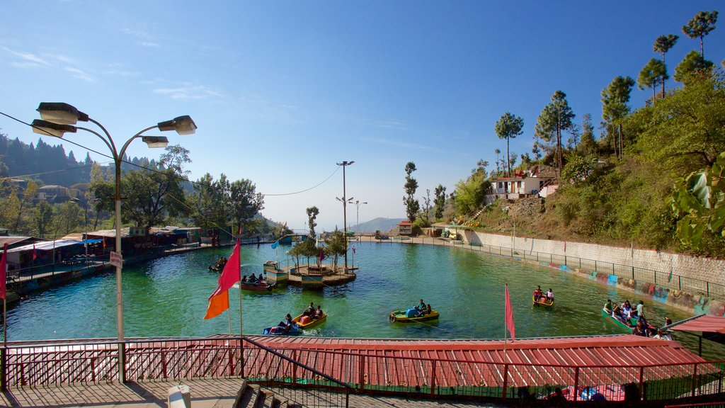 Mussoorie featuring a lake or waterhole and kayaking or canoeing