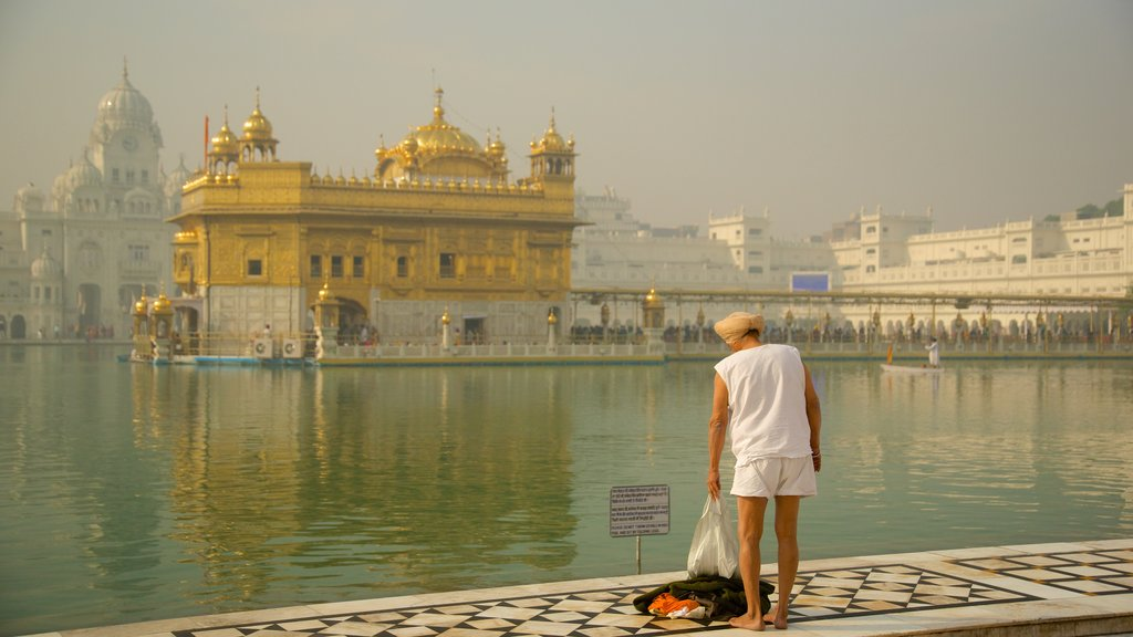 Golden Temple which includes a temple or place of worship, a lake or waterhole and heritage architecture