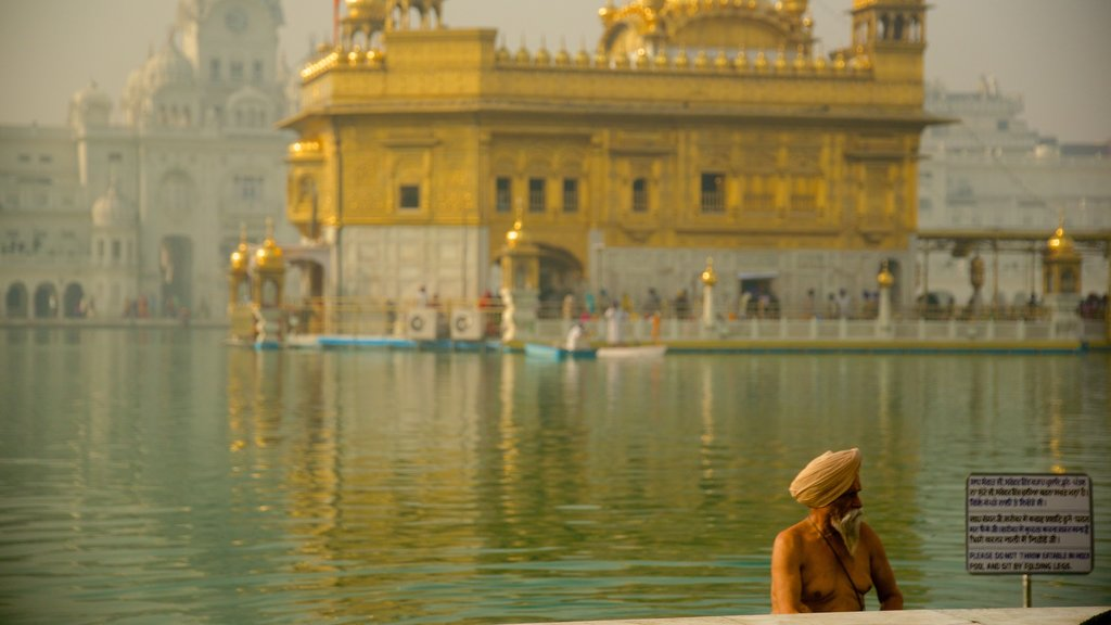 Golden Temple featuring heritage elements, a temple or place of worship and a lake or waterhole