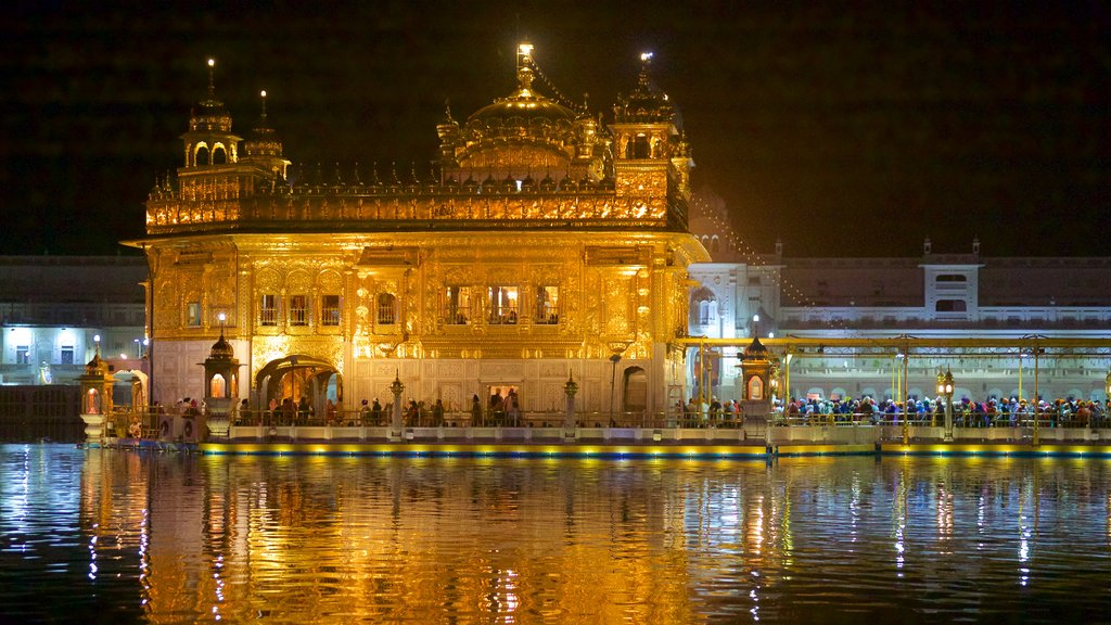 Golden Temple which includes night scenes, heritage elements and a lake or waterhole