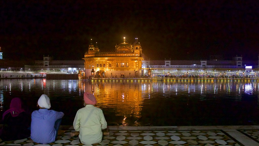 Golden Temple featuring a temple or place of worship, a lake or waterhole and night scenes