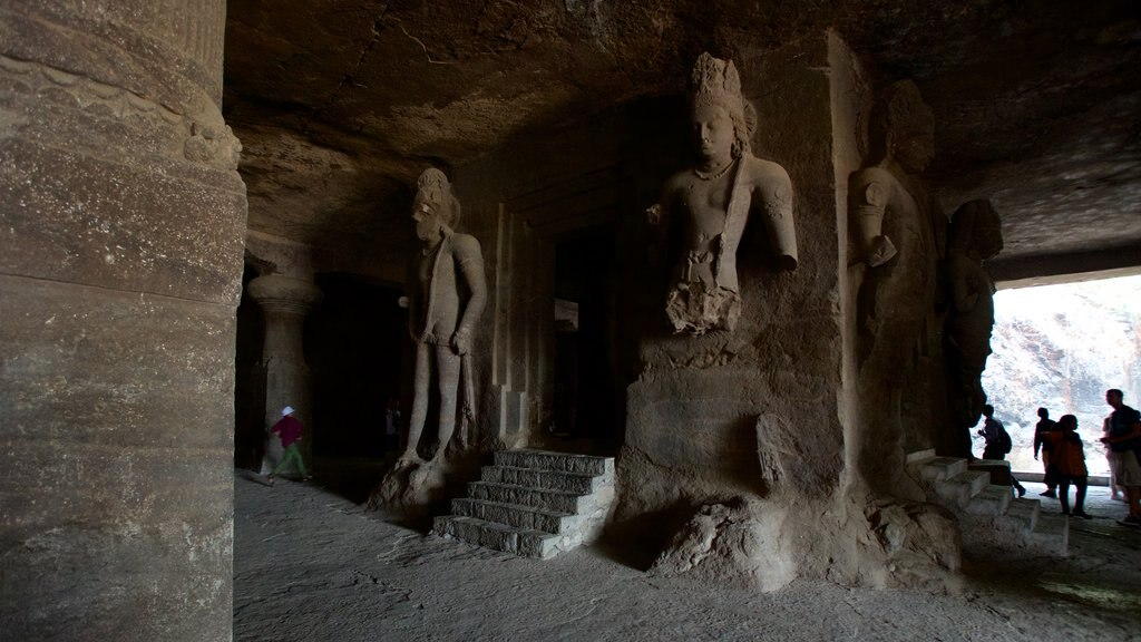 Elephanta Caves featuring a statue or sculpture, caves and heritage elements