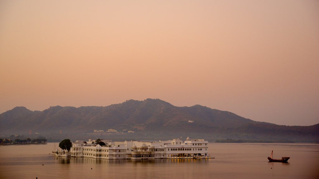 Lake Palace showing a lake or waterhole, island views and a sunset
