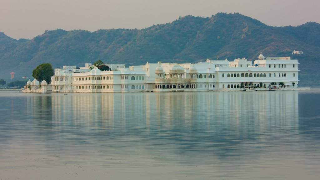 Lake Palace which includes island views, a lake or waterhole and a sunset