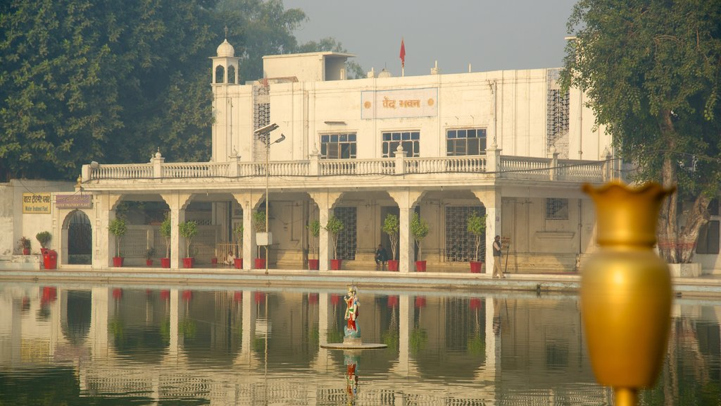 Durgiana Temple featuring heritage elements, a temple or place of worship and a lake or waterhole