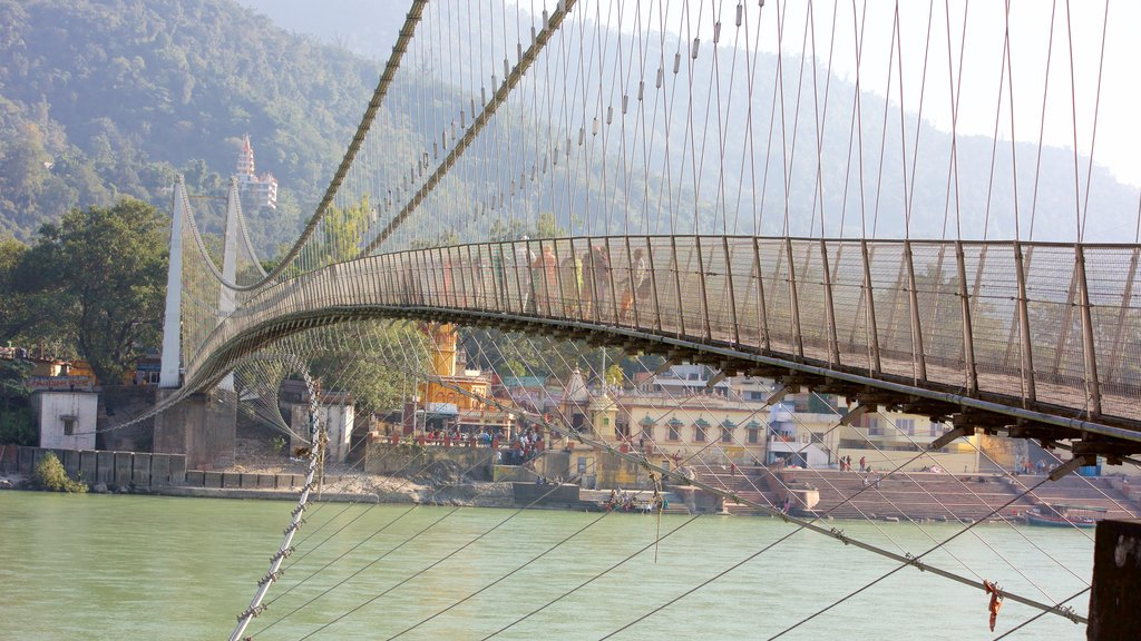 Ram Jhula featuring a small town or village, a river or creek and a bridge