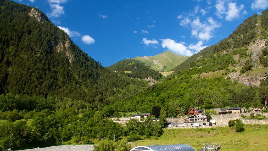 Arinsal which includes tranquil scenes, mountains and a small town or village