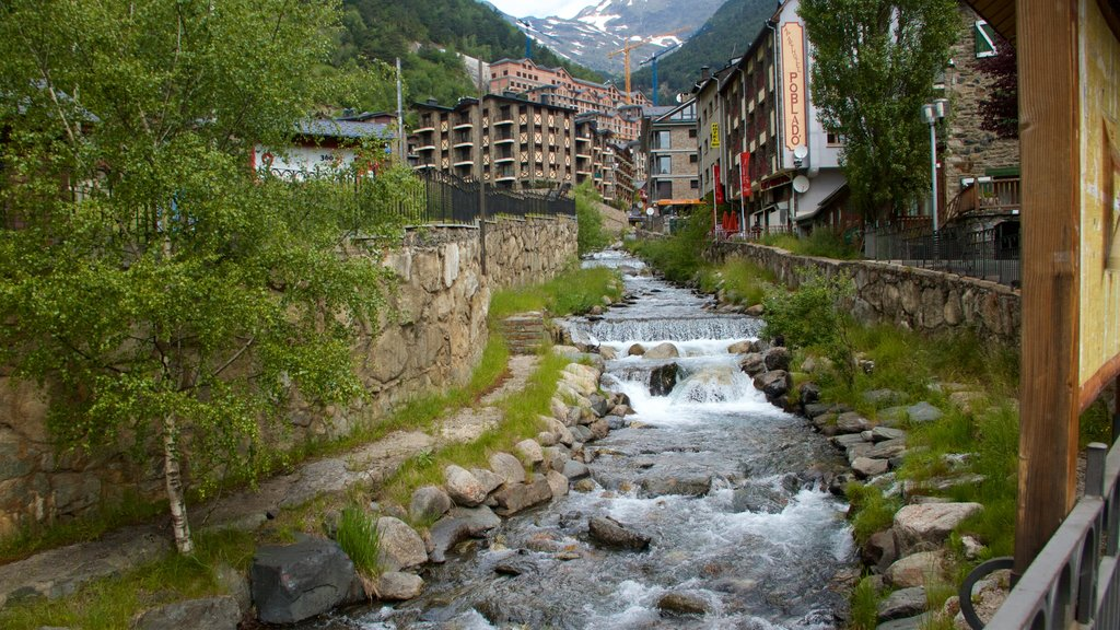Arinsal which includes a small town or village, a river or creek and a waterfall