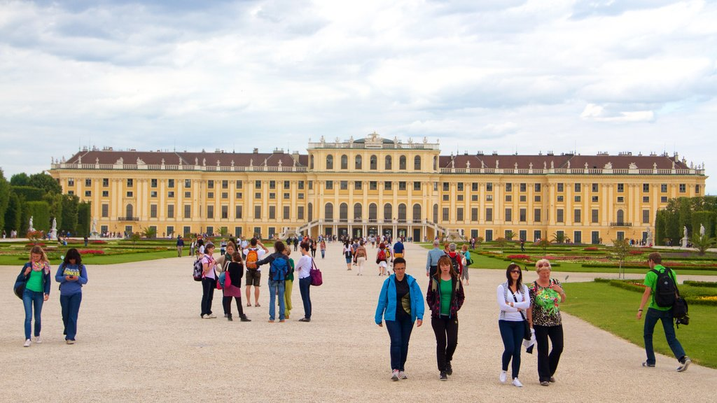 Schonbrunn which includes heritage architecture and a castle as well as a large group of people