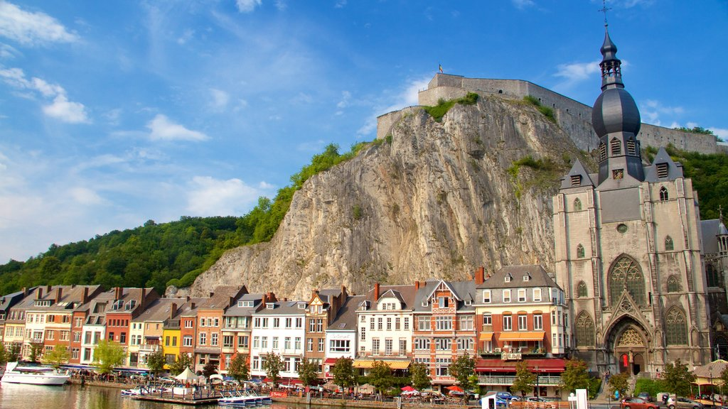 Dinant which includes heritage architecture and mountains