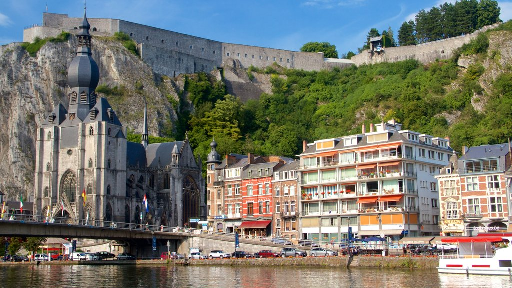 Dinant which includes a church or cathedral, a lake or waterhole and boating