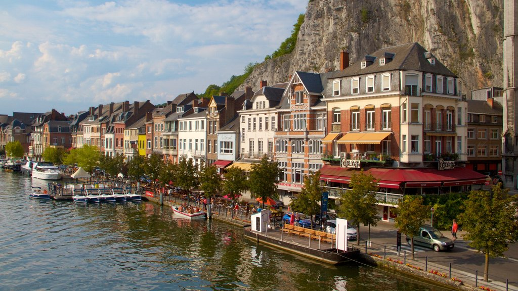 Dinant which includes heritage architecture and a lake or waterhole