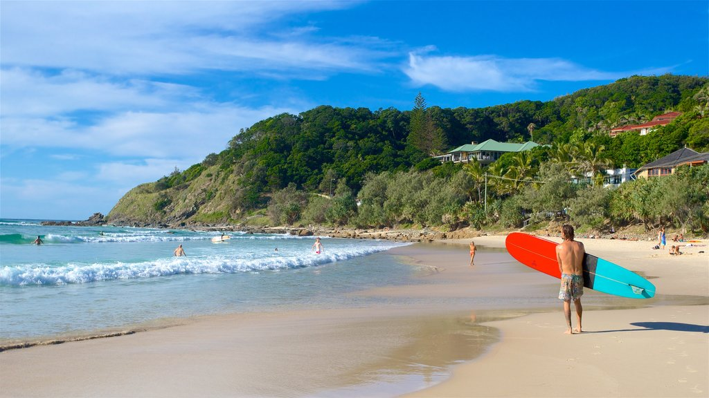 Wategos Beach which includes waves, a sandy beach and general coastal views