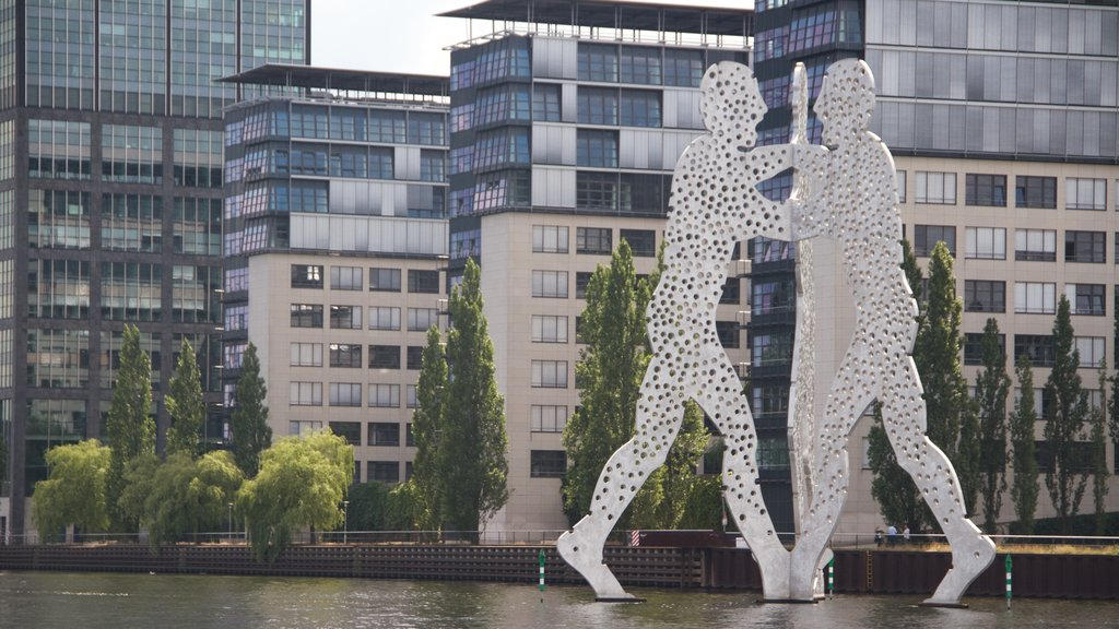 Berlin which includes modern architecture, outdoor art and a statue or sculpture