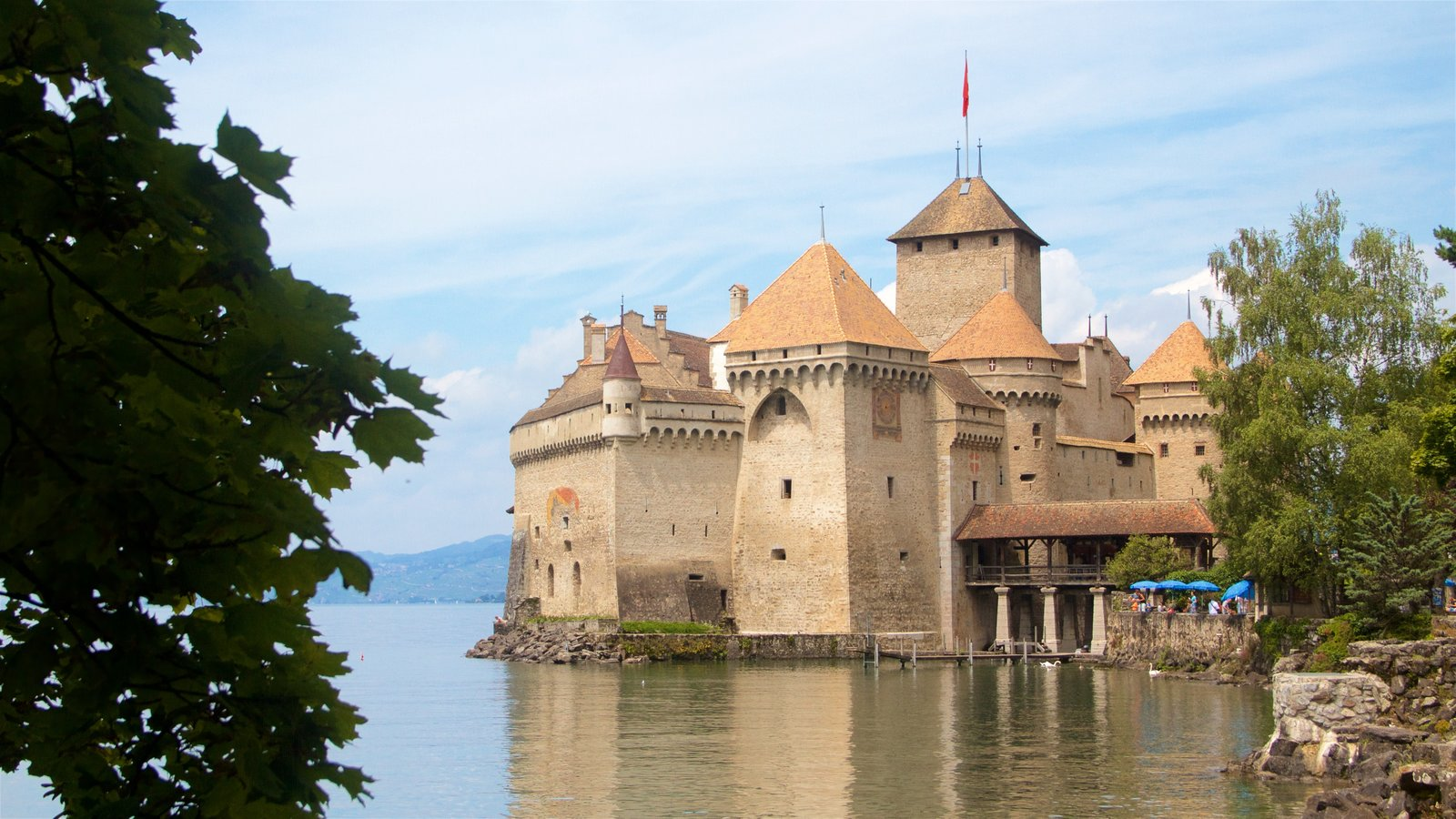 Chateau de Chillon which includes heritage architecture, a castle and a lake or waterhole