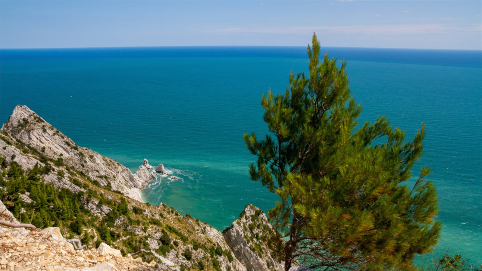 Sirolo which includes general coastal views and rugged coastline