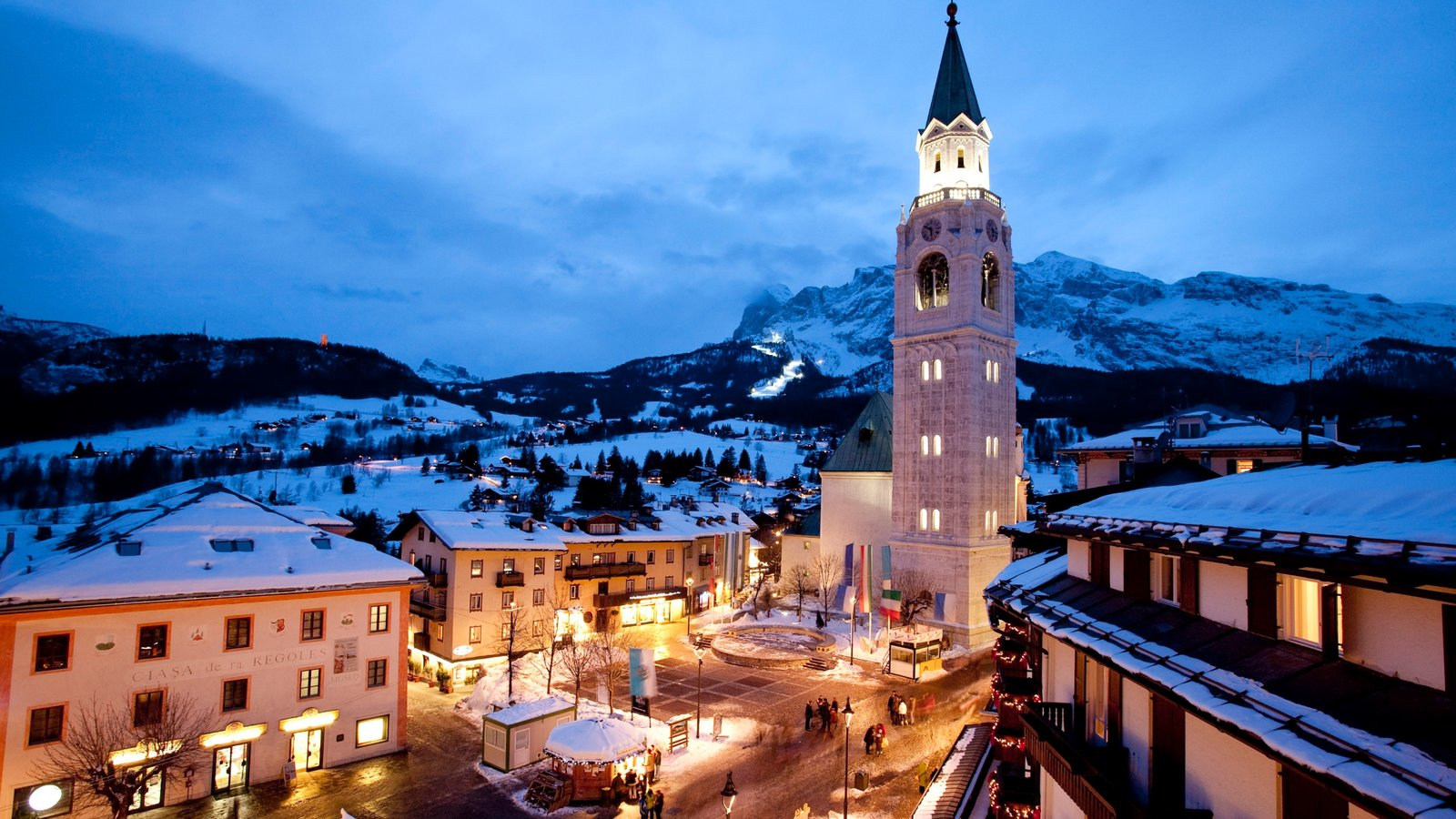 Cortina d\'Ampezzo which includes a church or cathedral, snow and a small town or village