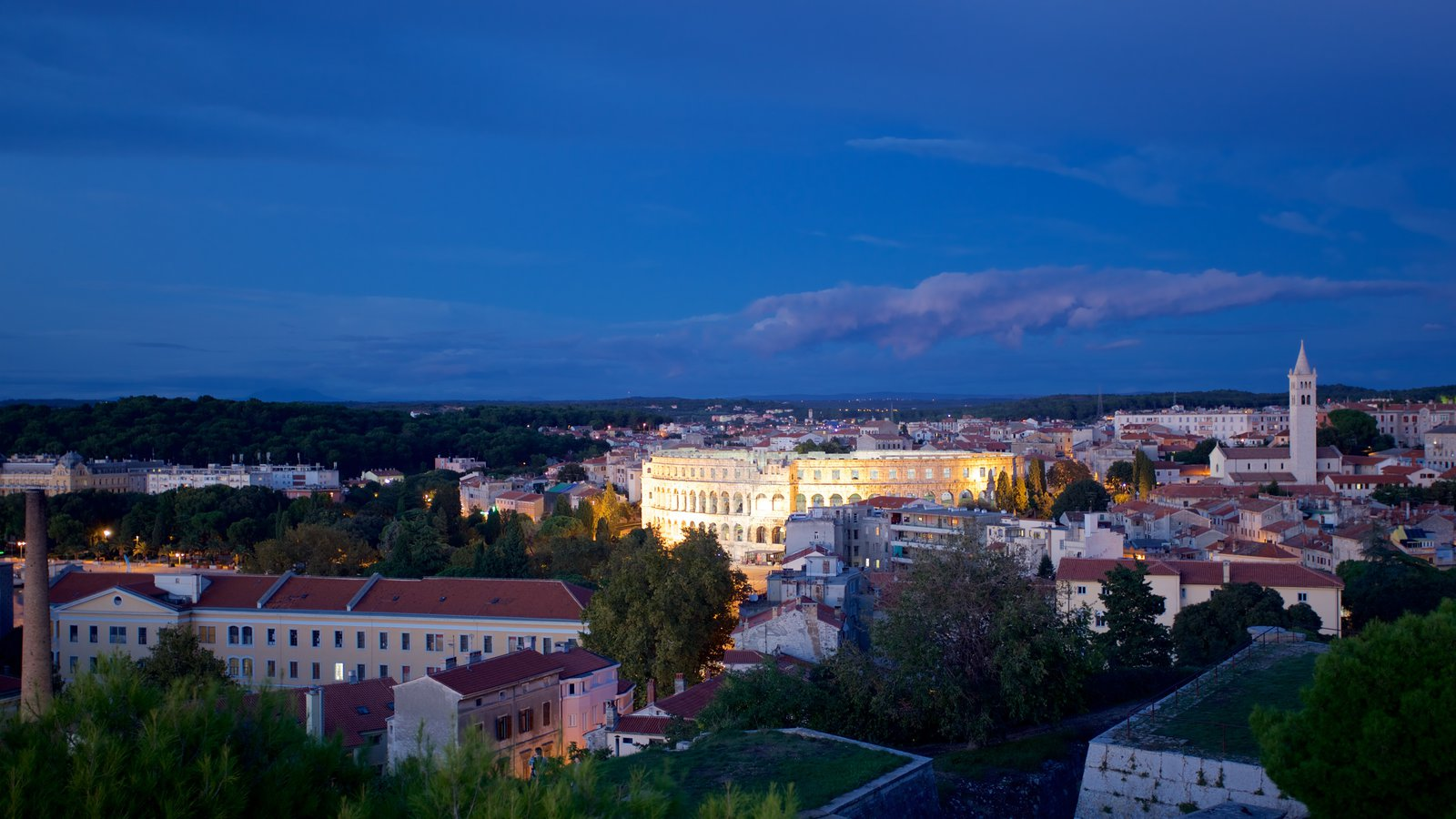 Pula featuring a city and night scenes