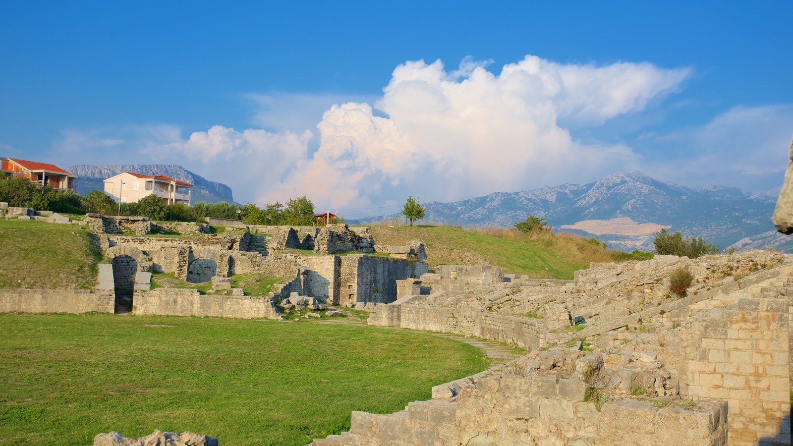 Salona Ruins featuring a ruin, mountains and tranquil scenes