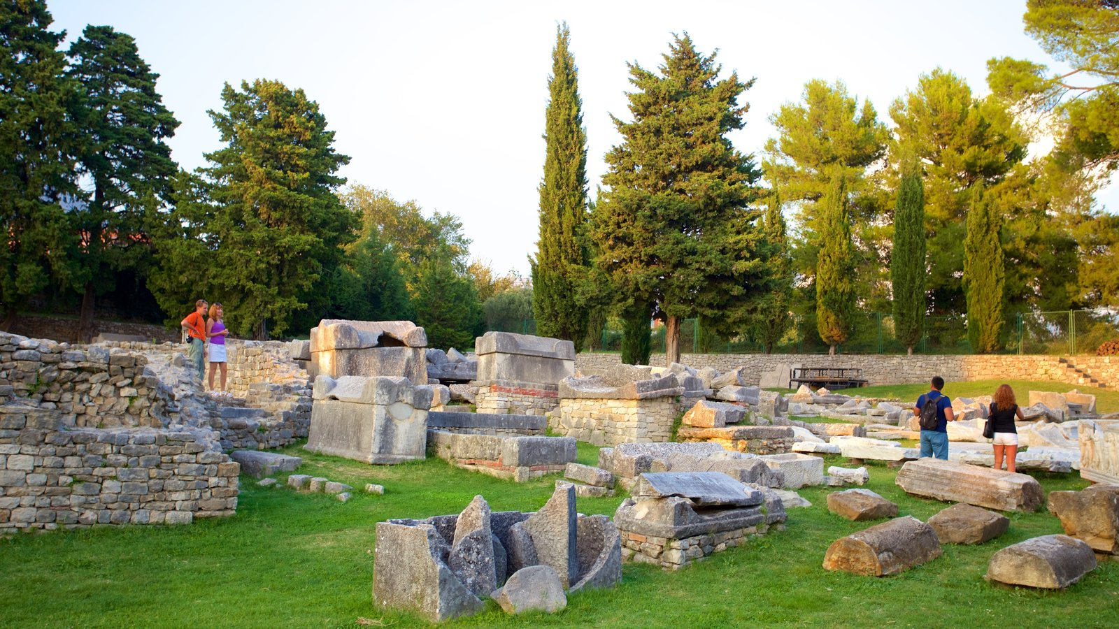 Salona Ruins showing heritage elements and building ruins as well as a small group of people