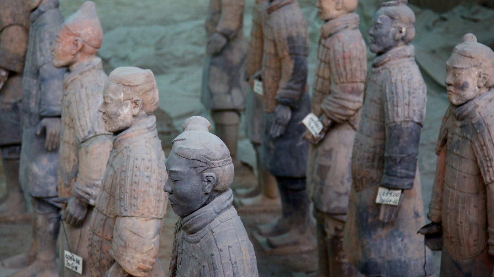 Terracota Army which includes a statue or sculpture and interior views