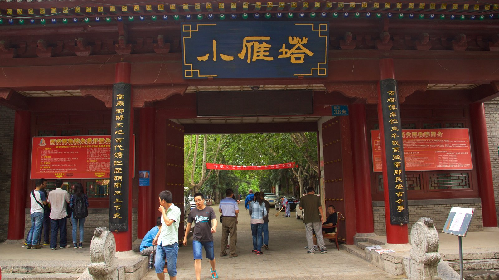 Giant Wild Goose Pagoda which includes a temple or place of worship and signage as well as a small group of people