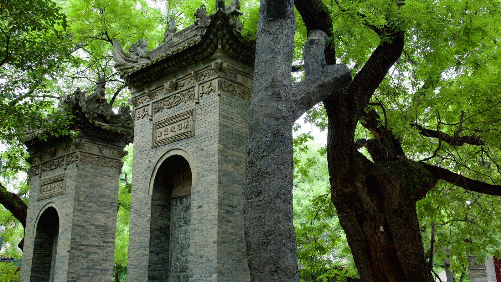 Giant Wild Goose Pagoda featuring a garden and a temple or place of worship