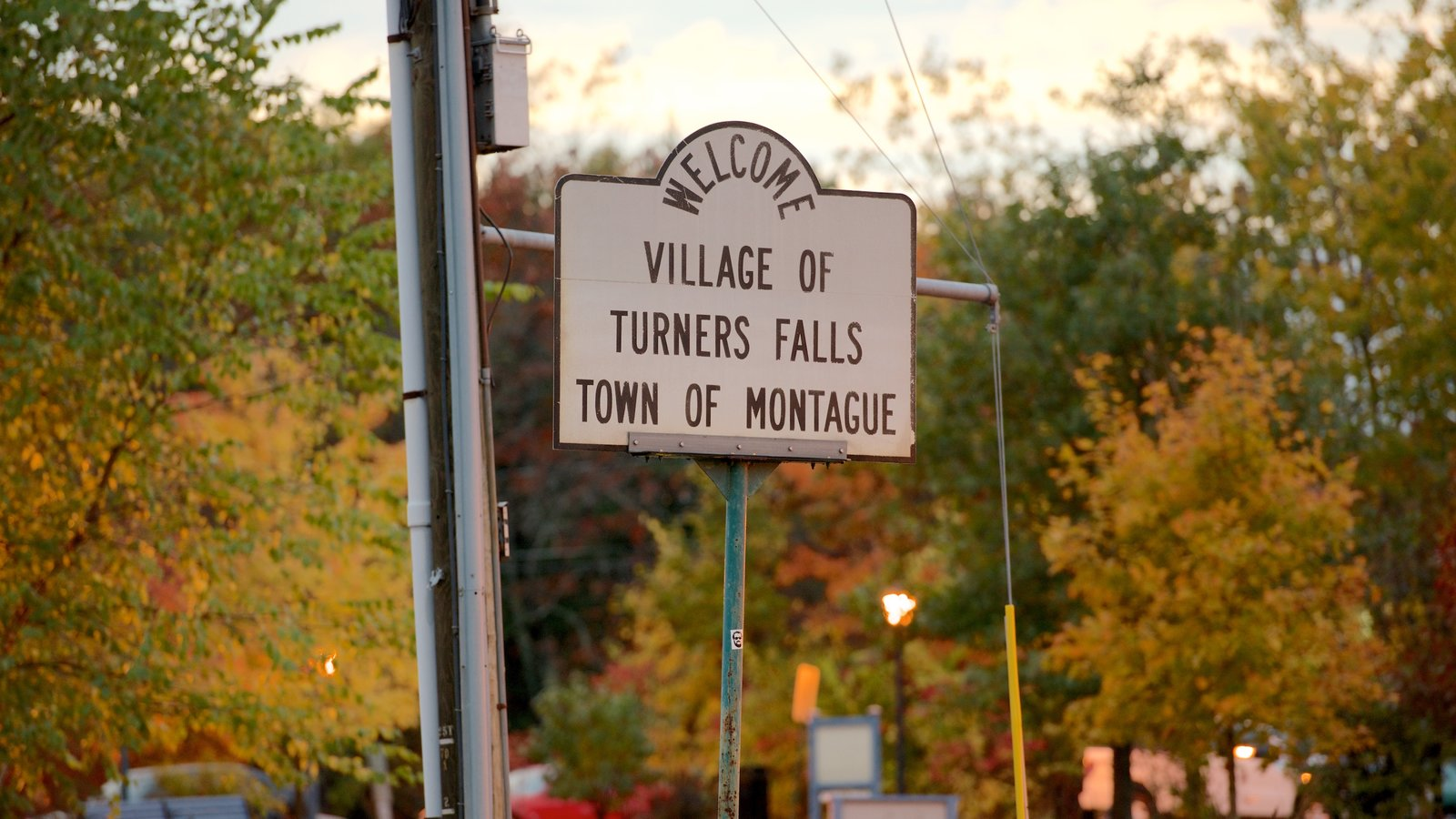 Turners Falls which includes signage and fall colors