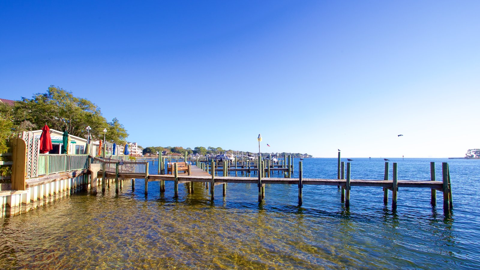 Fort Walton Beach which includes a sandy beach and a bay or harbor