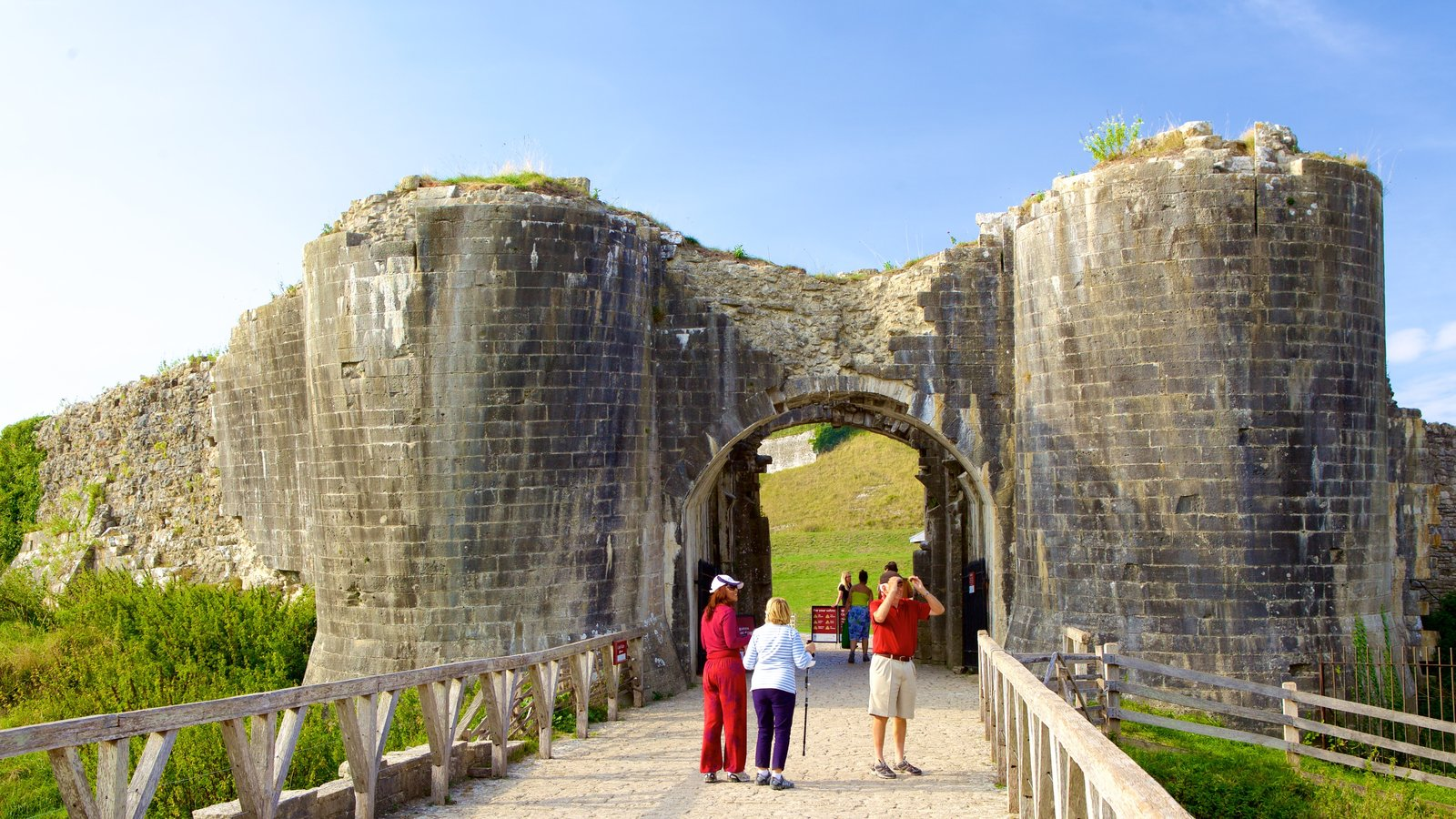 Corfe Castle which includes heritage elements and building ruins as well as a small group of people