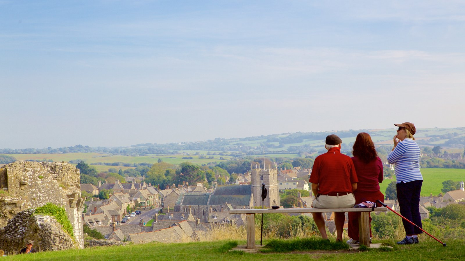 Corfe Castle featuring a small town or village as well as a small group of people