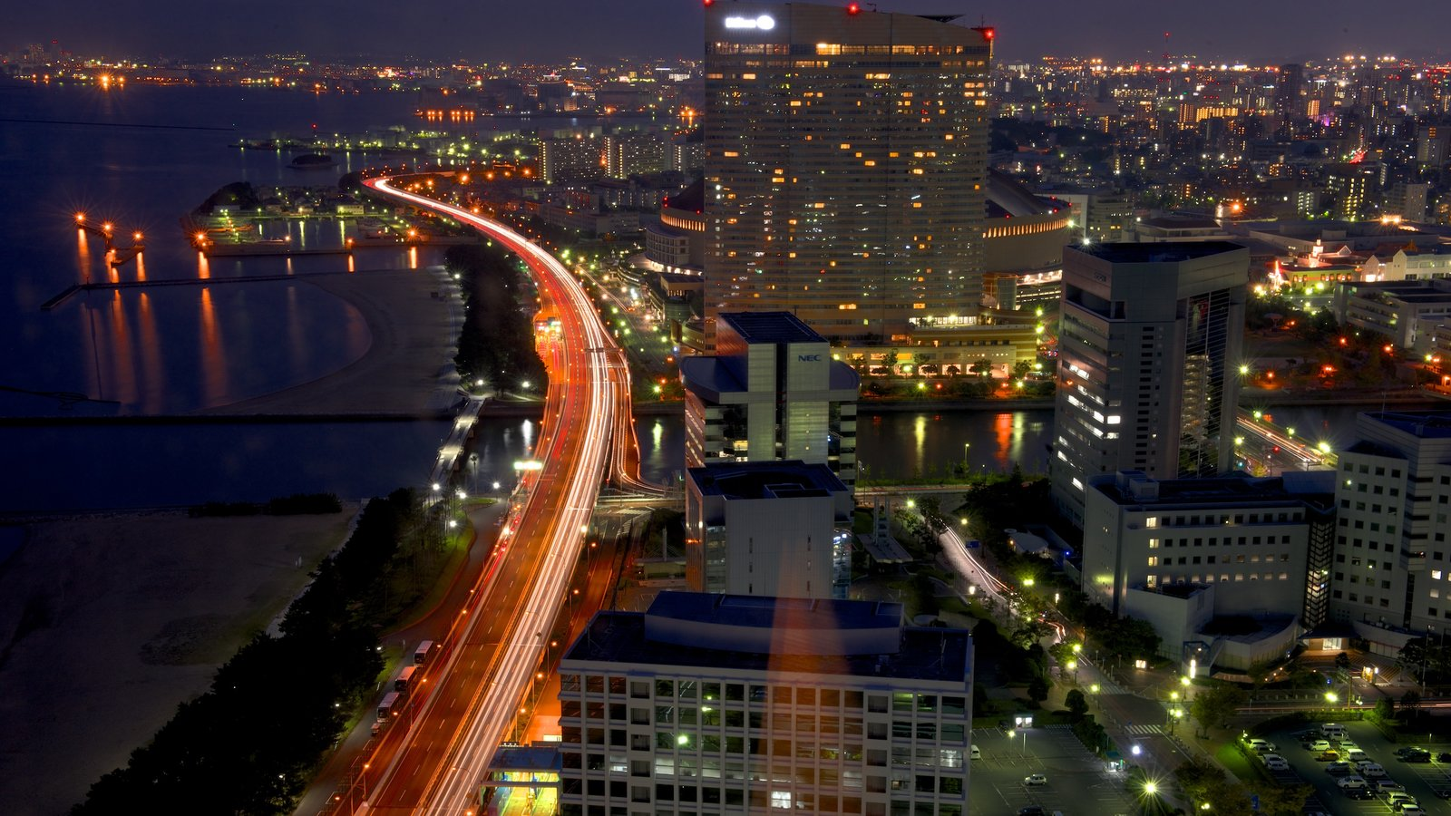 Fukuoka Tower showing a city and night scenes