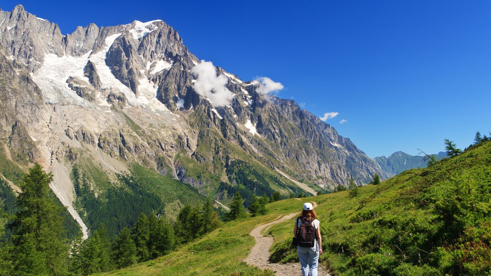 Courmayeur featuring hiking or walking and mountains as well as an individual femail